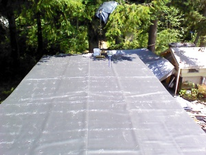 EPDM rolled out to relax before gluing it down