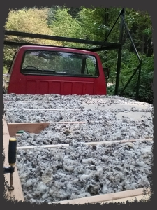 This is what sheep's wool insulation looks like.  Pretty much like sheep wool :p