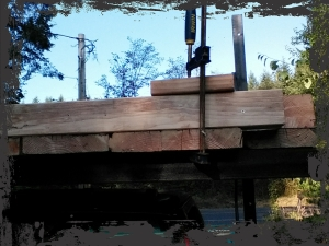 I used a block of wood to ensure the doubled joists stayed level with each other as I screwed each plank in from below.  Worked really well.