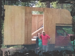 The two lovely neighbors who contributed about 2 1/2 hours to hold up the sheathing while I attached it.