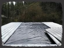Plastic under metal panels. Second flashing layer on skylight over plastic.