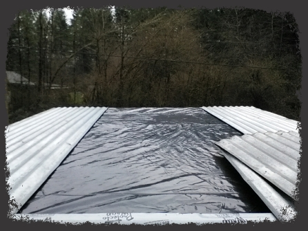 Plastic under metal panels. Second flashing layer on skylight over plastic.